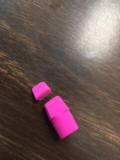 A pink cap eraser with the tip cut off.